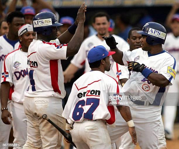 El jugador Miguel Tejada de Tigres de Licey de Republica Dominicana es felicitado por sus companeros tras anotar un home run ante los Venados de...