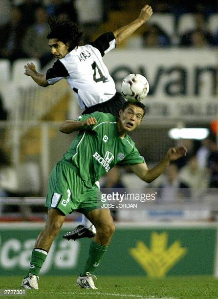 Valencial Argentinian Fabian Ayala vies with Macabi Haifas's Paraguayan Dante Lopez in a UEFA cup second round match in Mestalla Stadium in Valencia...