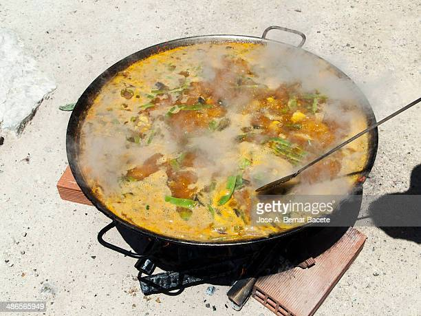 Valencian paella with fire of fuelwood in boiling