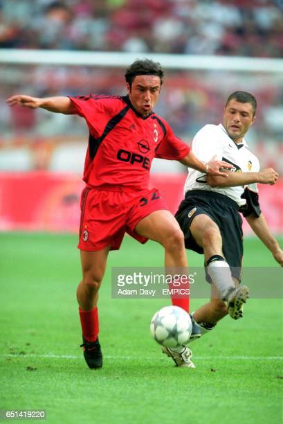 Valencia's Adrian Ilie challenges AC Milan's Cristian Brocchi