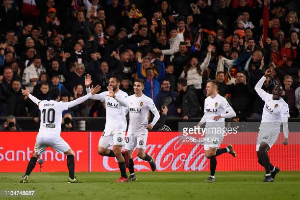 Valencia's Argentinian defender Ezequiel Garay celebrates scoring his team's second goal with teammates during the Spanish league football match...