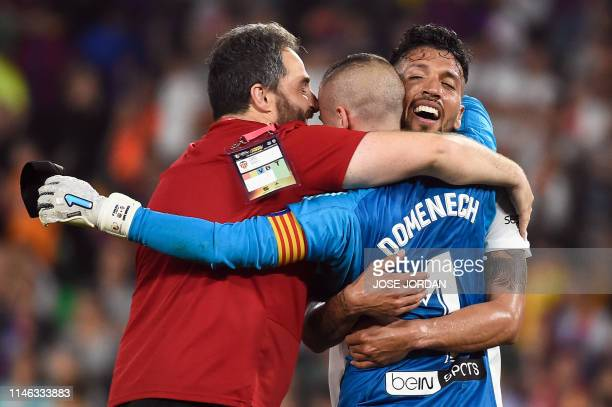 Valencia's Argentinian defender Ezequiel Garay celebrates with Valencia's Spanish goalkeeper Jaume Domenech at the end of the 2019 Spanish Copa del...