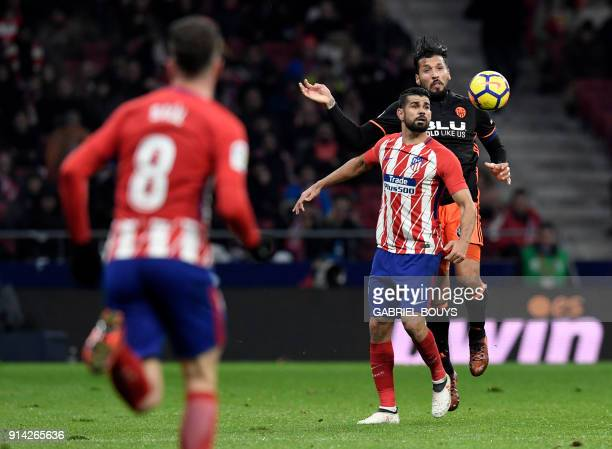 Valencia's Argentinian defender Ezequiel Garay vies with Atletico Madrid's Spanish forward Diego Costa during the Spanish league football match...