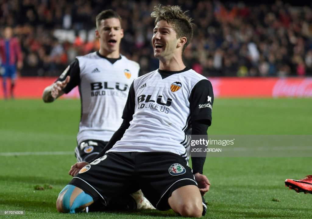 Valencia's Argentinian forward Luciano Vietto celebrates after scoring during the Spanish league football match between Valencia CF and Levante UD at the Mestalla stadium in Valencia on February 11, 2018. /