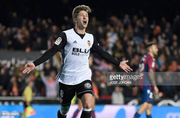 Valencia's Argentinian forward Luciano Vietto celebrates after scoring during the Spanish league football match between Valencia CF and Levante UD at...