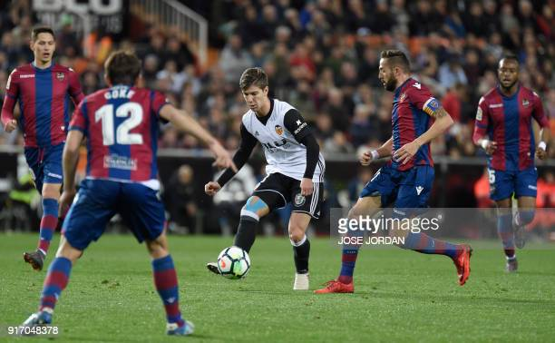 Valencia's Argentinian forward Luciano Vietto controls the ball during the Spanish league football match between Valencia CF and Levante UD at the...