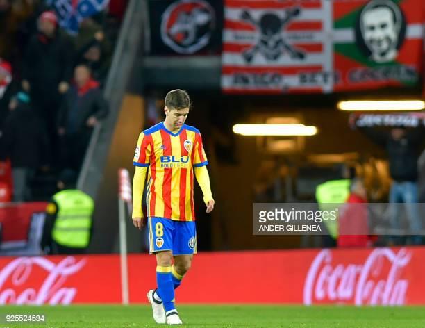 Valencia's Argentinian forward Luciano Vietto looks downwards after Athletic's score during the Spanish league football match Athletic Club Bilbao...