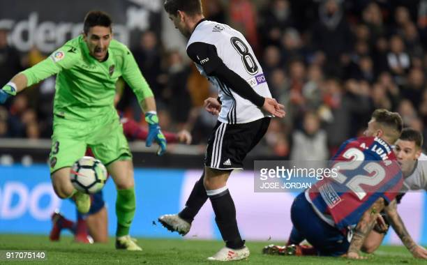 Valencia's Argentinian forward Luciano Vietto scores during the Spanish league football match between Valencia CF and Levante UD at the Mestalla...