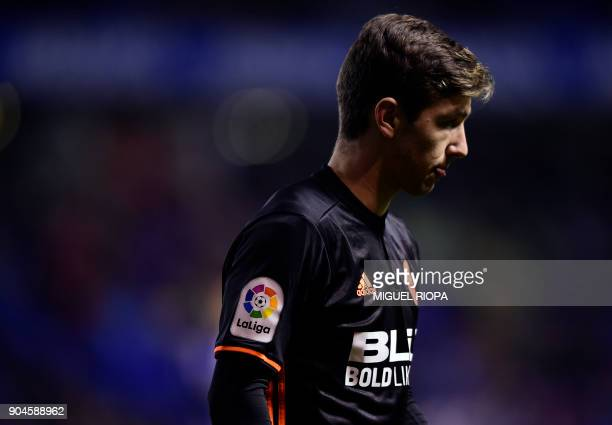 Valencia's Argentinian forward Luciano Vietto stands on the field during the Spanish league football match between RC Deportivo de la Coruna and...