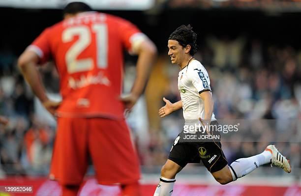 Valencia's Argentinian midfielder Alberto Costa celebrates after scoring during the Spanish league football match Valencia CF vs Sevilla on February...