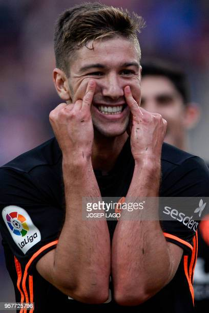 Valencia's Argentinian midfielder Luciano Vietto celebrates his goal during the Spanish league football match Girona FC vs Valencia CF at the...