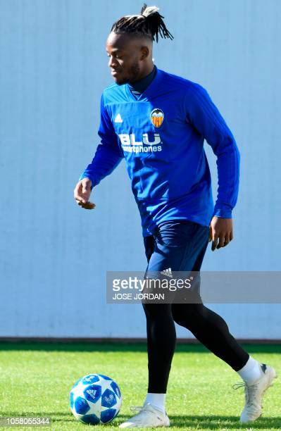 Valencia's Belgian forward Michy Batshuayi controls a ball during a training session at the Valencia sports city in Paterna on November 6 2018 on the...