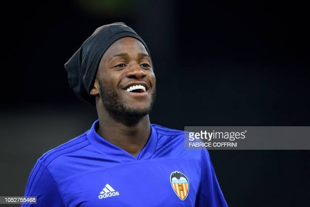 Valencia's Belgian forward Michy Batshuayi smiles during a training session on the eve of the UEFA Champions League group stage H football match...