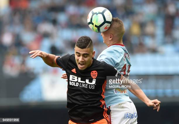 Valencia's Belgian midfielder Andreas Pereira jumps for the ball with Celta Vigo's Slovak midfielder Stanislav Lobotka during the Spanish league...