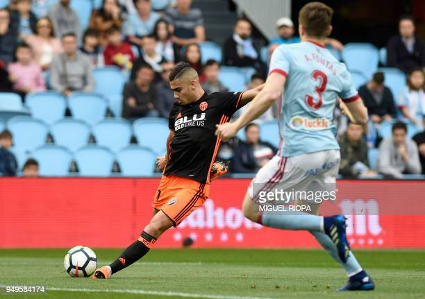 Valencia's Belgian midfielder Andreas Pereira kicks the ball next to Celta Vigo's Spanish defender Andreu Fontas during the Spanish league football...
