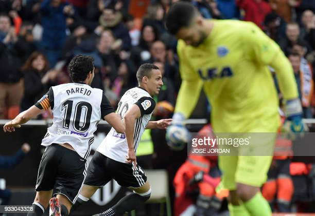 Valencia's Brazilborn Spanish forward Rodrigo Moreno celebrates a goal with Valencia's midfielder Dani Parejo during the Spanish League football...