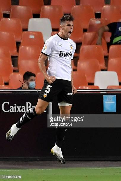 Valencia's Brazilian defender Gabriel Paulista celebrates after scoring a goal during the Spanish league football match Valencia CF against Levante...