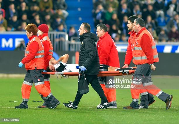 Valencia's Brazilian defender Gabriel Paulista is carried on a stretcher by medical personnel during the Spanish 'Copa del Rey' quarterfinal second...