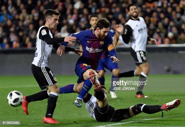 Valencia's Brazilian defender Gabriel Paulista vies with Barcelona's Argentinian forward Lionel Messi during the Spanish 'Copa del Rey' second leg...