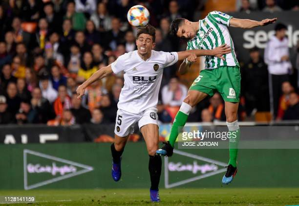 Valencia's Brazilian defender Gabriel Paulista vies with Real Betis' Spanish defender Marc Bartra during the Spanish Copa del Rey semifinal second...