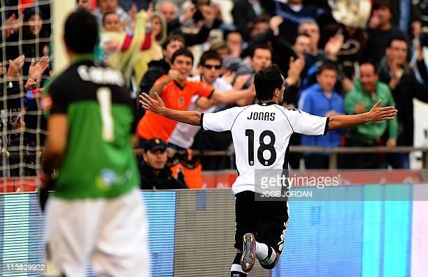 Valencia's Brazilian forward Jonas Goncalves Oliveira celebrates after scoring during the Spanish league football match Valencia vs Real Sociedad on...