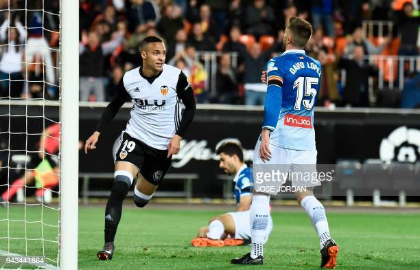 Valencia's Brazilian forward Rodrigo Moreno celebrates after scoring a goal during the Spanish league football match between Valencia CF and RCD...