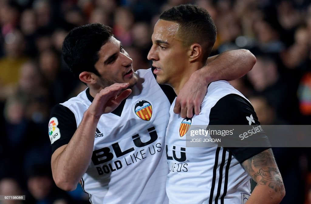 Valencia's Brazilian forward Rodrigo Moreno (R) celebrates with Valencia's Portuguese midfielder Manuel Guedes after scoring during the Spanish league football match Valencia CF against Real Betis at the Mestalla stadium in Valencia on March 04, 2018. /