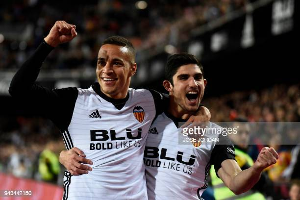 Valencia's Brazilian forward Rodrigo Moreno celebrates with Valencia's Portuguese midfielder Manuel Guedes after scoring a goal during the Spanish...