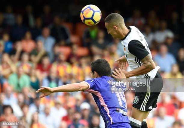 Valencia's Brazilian forward Rodrigo Moreno heads the ball to score a goal during the Spanish league footbal match Valencia CF vs Club Deportivo...