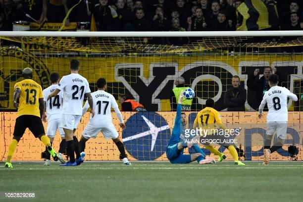 Valencia's Brazilian goalkeeper Neto stops the ball in front of Young Boys Ivorain forward Roger Assale during the UEFA Champions League group stage...