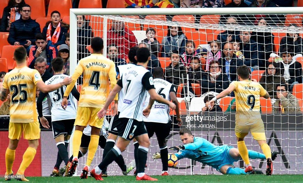 Valencia's Brazilian goalkeeper Norberto Murara Neto stops a shot on goal during the Spanish league football match between Valencia and Girona at the Mestalla stadium in Valencia on January 6, 2018. /