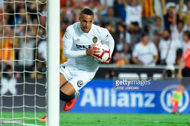Valencia's Brazilianborn Spanish forward Rodrigo Moreno celebrates after scoring a goal during the Spanish League football match between Valencia and...