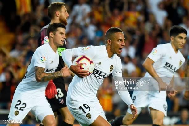 Valencia's Brazilianborn Spanish forward Rodrigo Moreno celebrates with teammates after scoring a goal during the Spanish League football match...