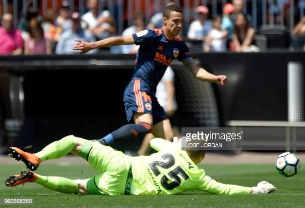 Valencia's Brazilianborn Spanish forward Rodrigo Moreno vies with Deportivo La Coruna's Ukrainian goalkeeper Maksym Koval during the Spanish league...