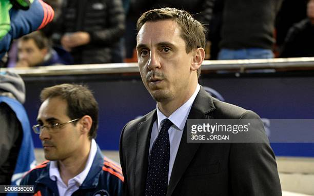 Valencia's Britihs coach Gary Neville gestures from the sideline during the UEFA Champions League football match Valencia CF vs Olympique Lyonnais at...
