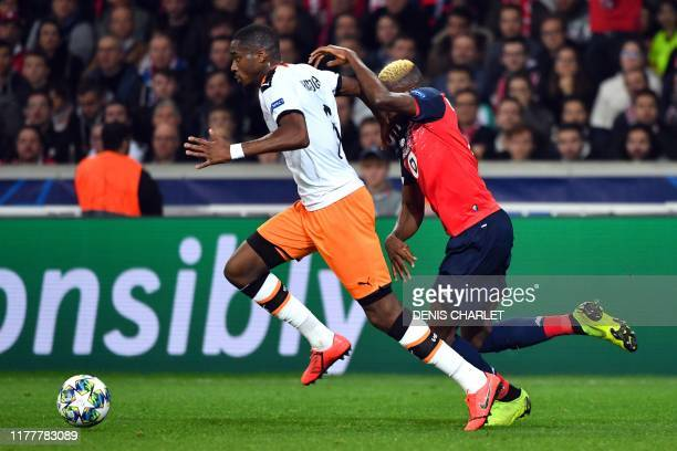 Valencia's Central African RepublicFrench midfielder Geoffrey Kondogbia and Lille's Nigerian forward Victor Osimhen vie for the ball during the UEFA...