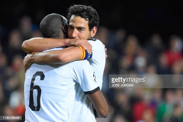 Valencia's Central African RepublicFrench midfielder Geoffrey Kondogbia celebrates with Valencia's Spanish midfielder Daniel Parejo after scoring a...