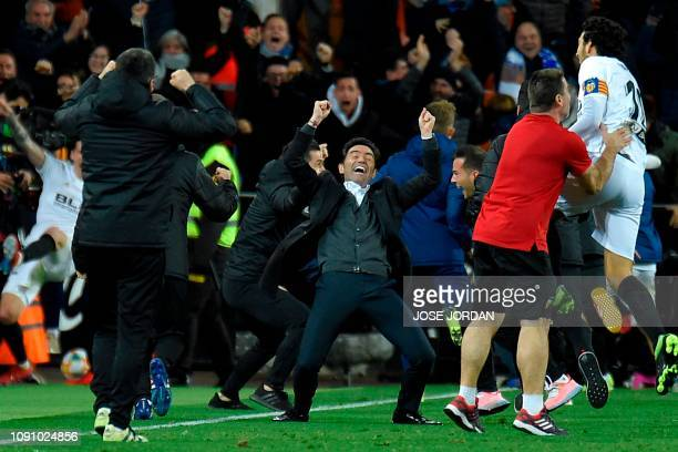 TOPSHOT Valencia's coach Marcelino celebrates as his team scores a third goal in extra time during the Spanish Copa del Rey quarterfinal second leg...