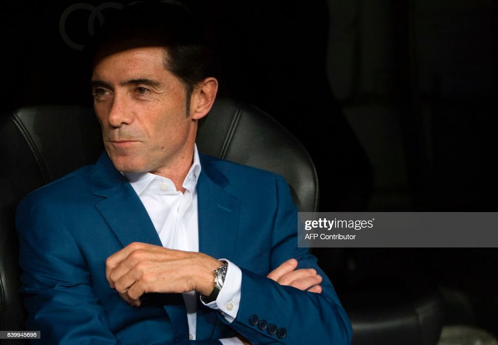 Valencia's coach Marcelino Garcia Toral looks on before the Spanish league football match Real Madrid CF vs Valencia CF at the Santiago Bernabeu stadium in Madrid on August 27, 2017. /