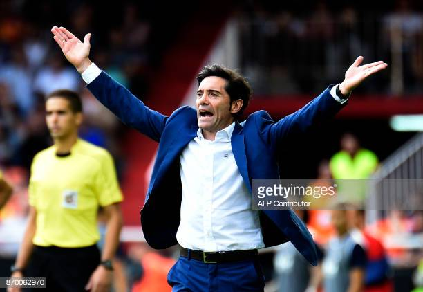Valencia's coach Marcelino gestures on the sideline during the Spanish league footbal match Valencia CF vs Club Deportivo Leganes SAD at the Mestalla...