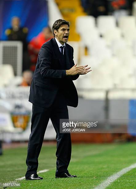 Valencia's coach Mauricio Pellegrino reacts during the UEFA Champions League football match Valencia CF vs FC Bate Borisov at the Mestalla stadium in...
