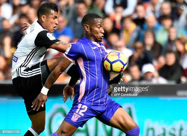 Valencia's Colombian defender Jeison Murillo vies with Leganes' Guadeloupean forward Claudio Beauvue during the Spanish league footbal match Valencia...