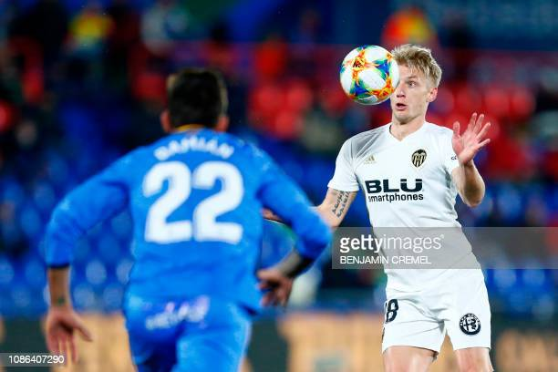 Valencia's Danish midfielder Daniel Wass eyes the ball during the Spanish Copa del Rey quarterfinal first leg football match between Getafe and...
