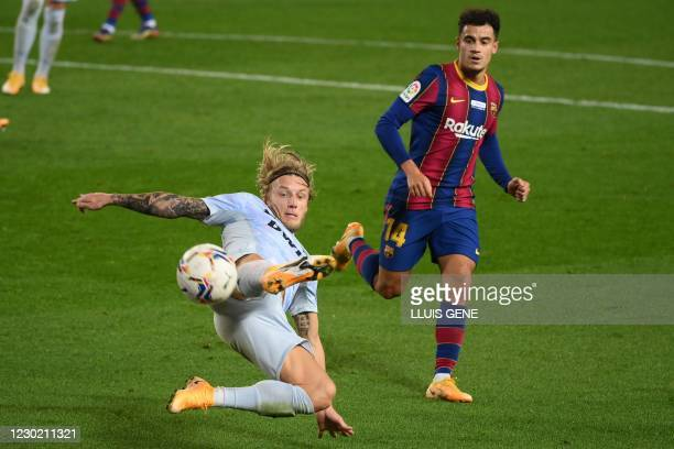 Valencia's Danish midfielder Daniel Wass vies with Barcelona's Brazilian midfielder Philippe Coutinho during the Spanish league football match...