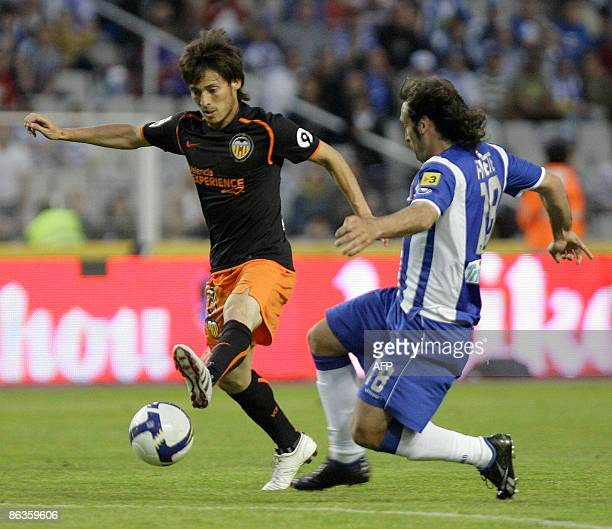 Valencia's David Silva fights for the ball with Espanyol's Francisco Joaquin Perez Rufete during their Spanish League football match against...