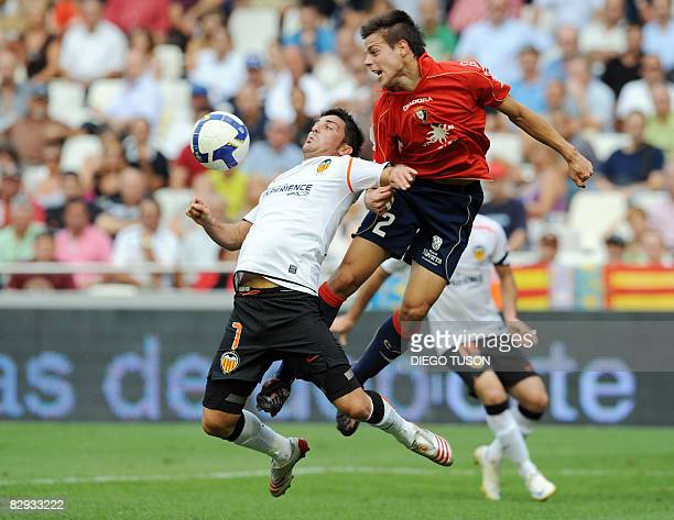 Valencia's David Villa fights for the ball with Osasuna's Cesar Azpilicueta during their Spanish league football match at Mestalla Stadium in...