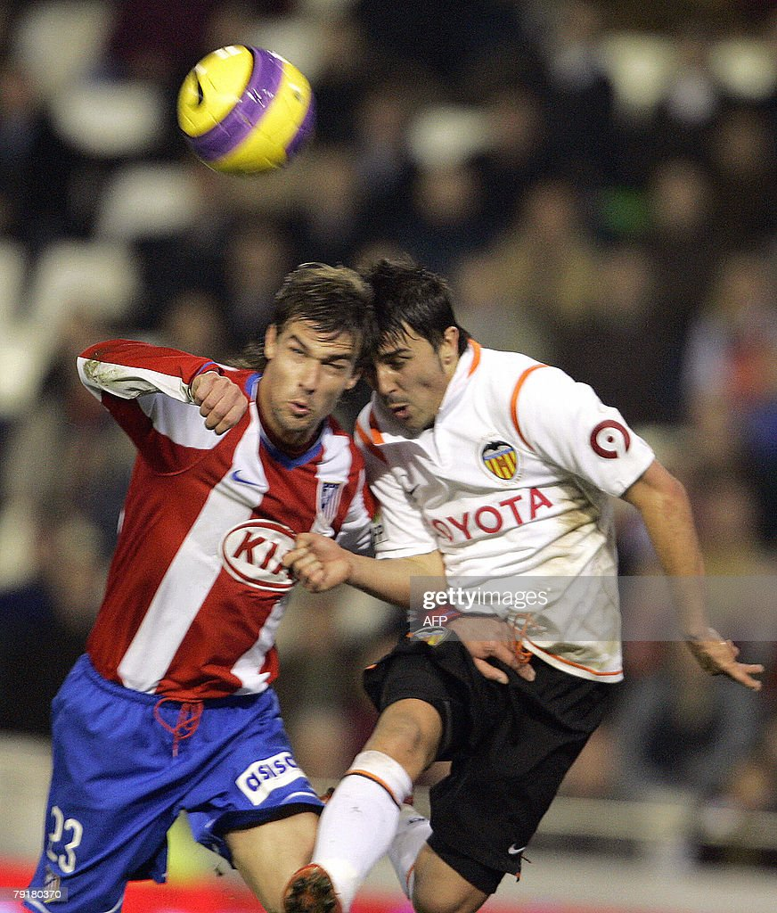 Valencia's David Villa (R) figths for the ball with Atletico Madrid's Argentinian Juan Valera during their Spanish King cup football match at Mestalla Stadium in Valencia, 23 January 2008.