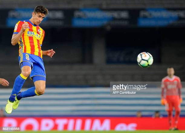 Valencia's defender from Brazil Gabriel Paulista heads the ball during the Spanish league football match Real Sociedad vs Valencia CF at the Anoeta...