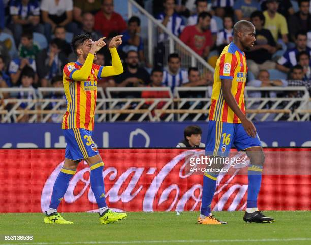 Valencia's defender from Spain Nacho Vidal celebrates after scoring his team's second goal during the Spanish league football match Real Sociedad vs...