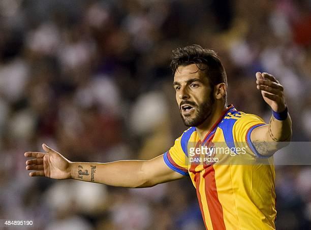 Valencia's forward Alvaro Negredo gestures during the Spanish league football match Rayo Vallecano de Madrid vs Valencia CF at Vallecas stadium in...